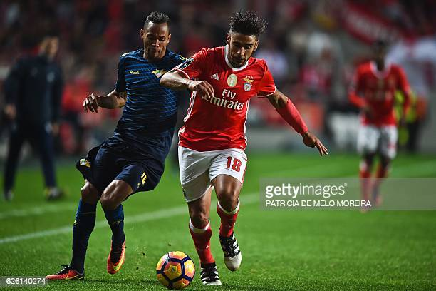 Benfica's Argentine midfielder Eduardo Salvio vies with Moreirense's Brazilian midfielder Nildo Gomes during the Portuguese league football match SL...