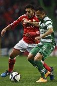 Benfica's Argentine midfielder Eduardo Salvio vies with Sporting's Brazilian defender Jefferson Nascimento during the Portuguese league football...
