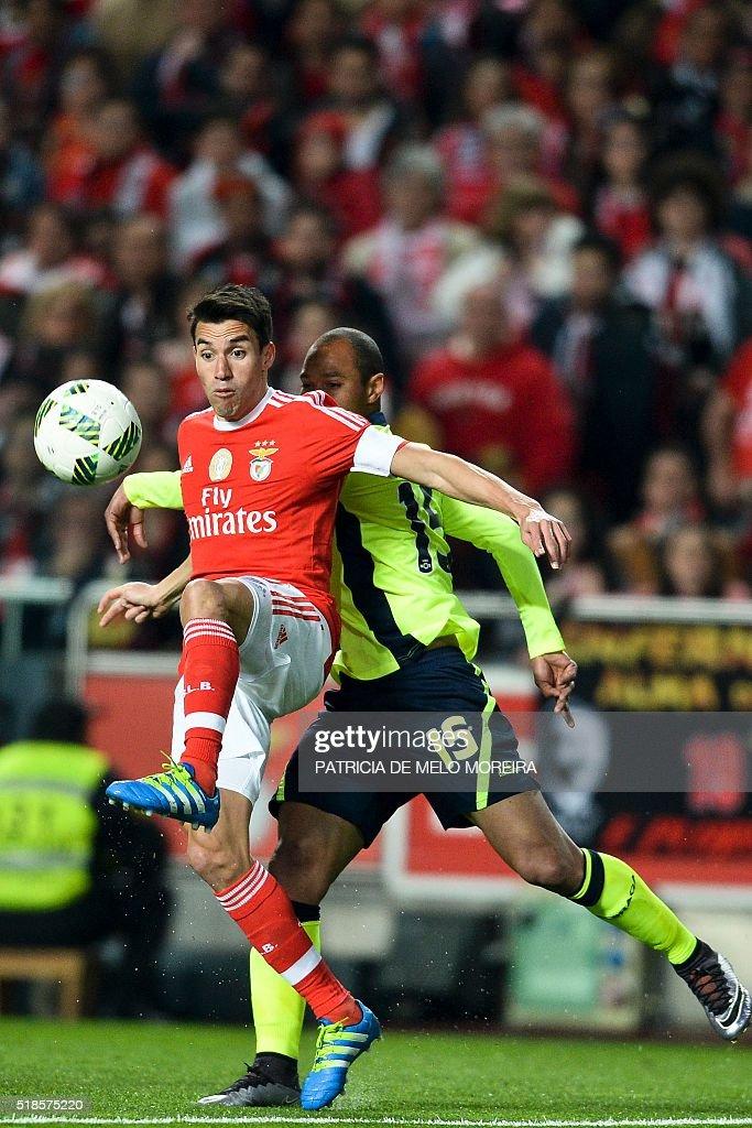 Benfica's Argentine midfielder Nicolas Gaitan vies with Braga's Brazilian defender Baiano during the Portuguese Liga football match Benfica vs SC...