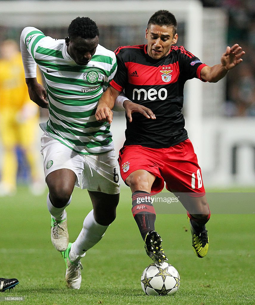 Benfica's Argentinian defender Eduardo Salvio competes with Celtic's Kenyan striker Victor Wanyama during an UEFA Champions League group G football match on September 19, 2012 at Parkhead in Glasgow.