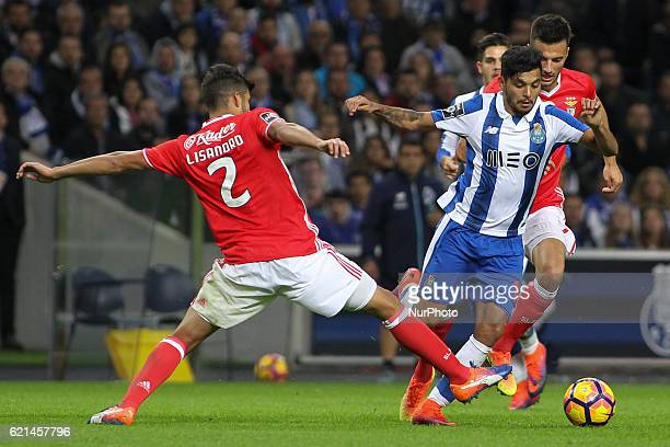 Benfica's Argentinian defender Lisandro Lopez with Porto's Mexican forward Jesus Corona during the Premier League 2016/17 match between FC Porto and...