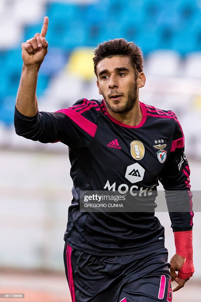 Benfica's Argentinian forward <a gi-track='captionPersonalityLinkClicked' href=/galleries/search?phrase=Eduardo+Salvio&family=editorial&specificpeople=5670924 ng-click='$event.stopPropagation()'>Eduardo Salvio</a> celebrates after scoring a goal during the Portuguese league football match CS Maritimo vs SL Benfica at the Barreiros stadium, in Funchal on January 18, 2015.