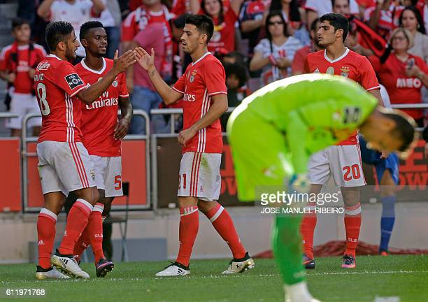 Benfica's Argentinian forward Eduardo Salvio celebrates his goal with mate defender Nelson Semedo and forward Pizzi during the Portuguese league...