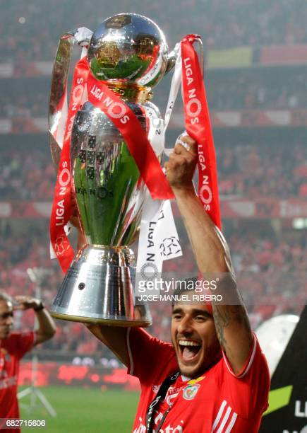 Benfica's Argentinian forward Eduardo Salvio holds the cup after winning their 36th title at the end of the Portuguese league football match SL...