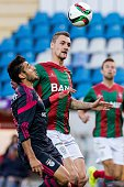 Benfica's Argentinian forward Eduardo Salvio vies with Maritimo's German defender Patrick Bauer during the Portuguese league football match CS...