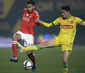 Benfica's Argentinian forward Eduardo Salvio vies with Pacos Ferreira's midfielder Vasco Rocha during the Portuguese league football match FC Pacos...