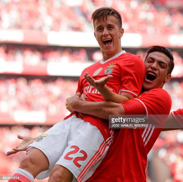 Benfica's Argentinian forward Franco Cervi celebrates with Mexican forward Raul Jimenez after scoring during the Portuguese league football match SL...