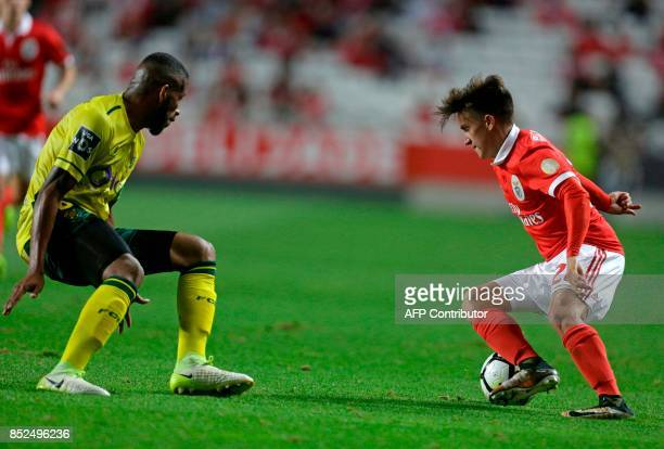 Benfica's Argentinian forward Franco Cervi vies with Pacos Ferreira's Brazilian defender Bruno Santos during the Portuguese league football match SL...