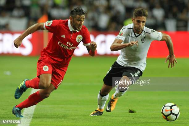 Benfica's Argentinian forward Toto Salvio with Vitoria SC's Portuguese forward joao vigario in action during the Candido Oliveira Super Cup match...