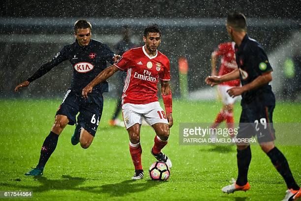 Benfica's Argentinian midfielder Eduardo Salvio vies with Belenenses' midfielder Joao Palhinha during the Portuguese league football match between OS...