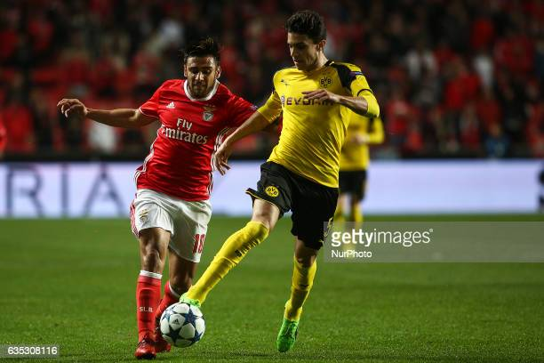 Benfica's Argentinian midfielder Eduardo Salvio vies with Dortmund's defender Bartra during the Champions League football match between SL Benfica...