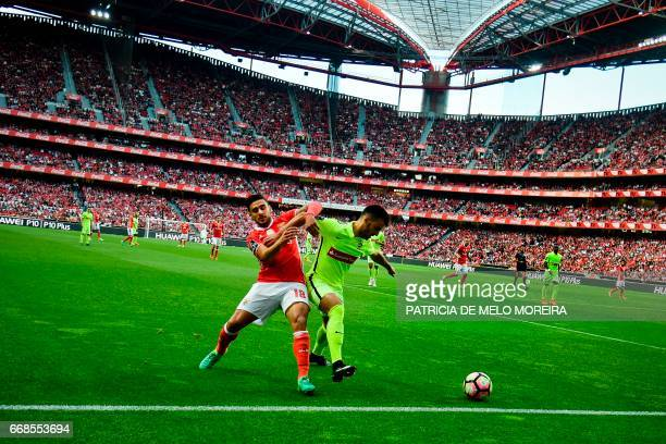 Benfica's Argentinian midfielder Eduardo Salvio vies with Maritimo's defender Luis Martins during the Portuguese league football match SL Benfica vs...
