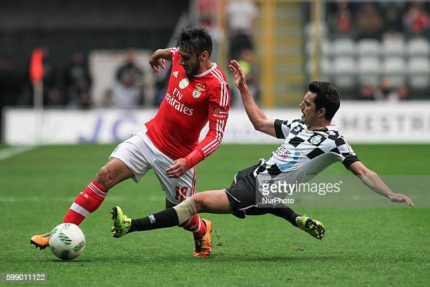 Benfica's Argentinian midfielder Eduardo Salvio with Boavista's Portuguese forward Mário Martins during the Premier League 2015/16 match between...