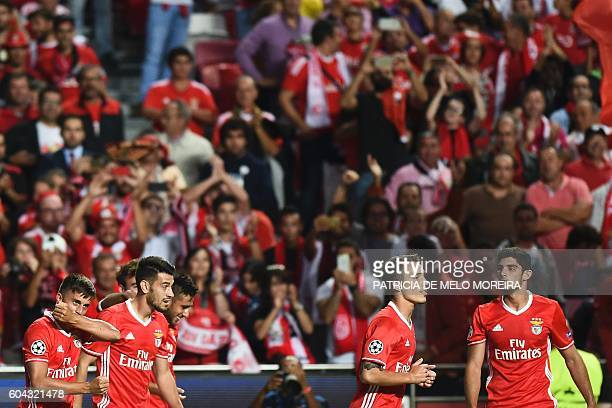Benfica's Argentinian midfielder Franco Cervi celebrates a goal with teammates during the UEFA Champions League football match SL Benfica vs Besiktas...