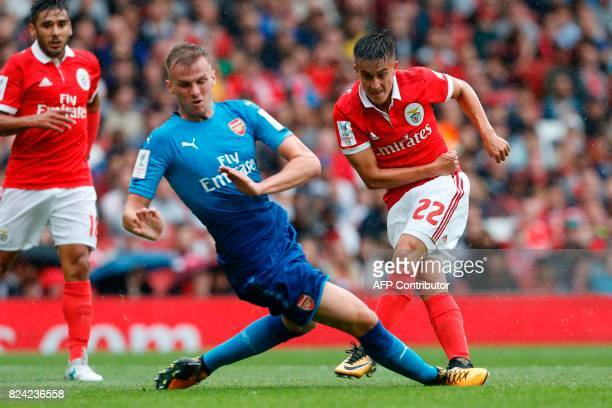 Benfica's Argentinian striker Franco Cervi shoots past Arsenal's English defender Rob Holding to score the opening goal of the preseason friendly...