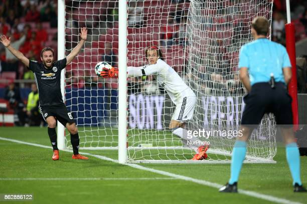 Benfica's Belgian goalkeeper Mile Svilar misses a safe after Manchester United's forward Marcus Rashford shoots to score during the UEFA Champions...