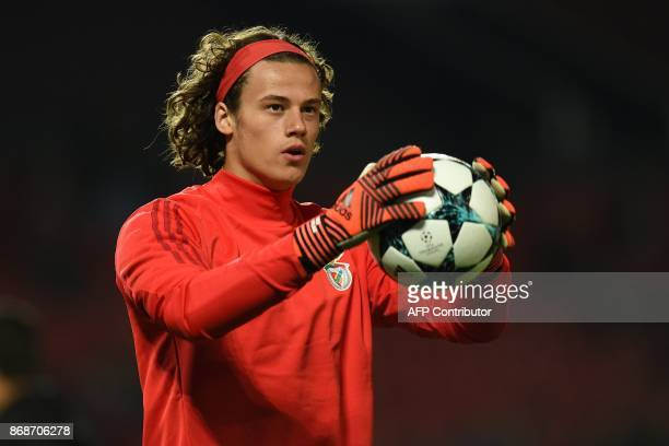 Benfica's Belgian goalkeeper Mile Svilar warms up ahead of the UEFA Champions League Group A football match between Manchester United and Benfica at...