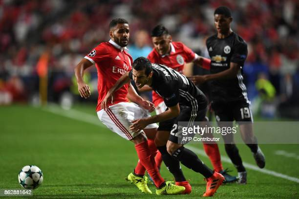 Benfica's Brazilian defender Douglas dos Santos vies with Manchester United's Armenian midfielder Henrikh Mkhitaryan during the UEFA Champions League...