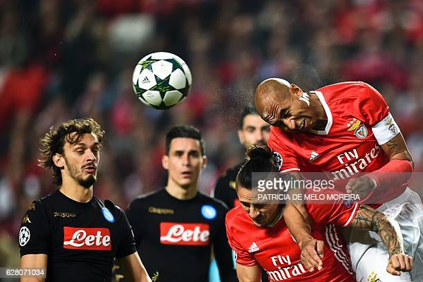 Benfica's Brazilian defender Luisao da Silva heads the ball during the UEFA Champions League Group B football match SL Benfica vs SSC Napoli at the...