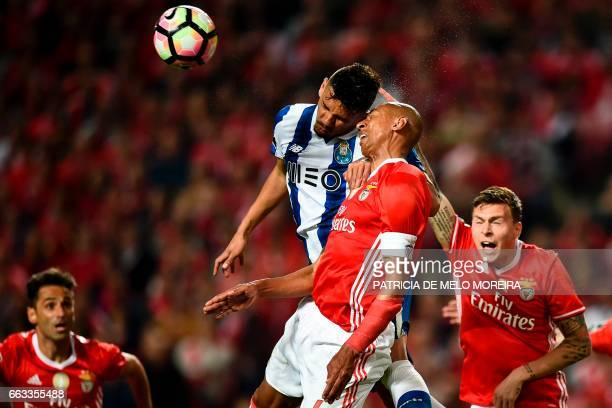 Benfica's Brazilian defender Luisao da Silva heads the ball with Porto's Brazilian forward Francisco Soares during the Portuguese league football...