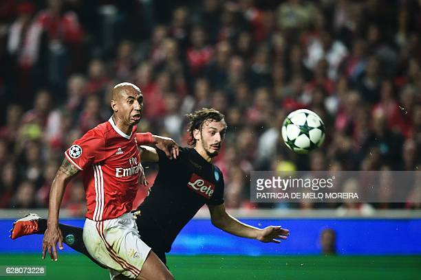 Benfica's Brazilian defender Luisao da Silva vies with Napoli's forward Manolo Gabbiadini during the UEFA Champions League Group B football match SL...