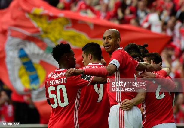 Benfica's Brazilian defender Luisao hugs his teammates after their fifth goal scored by Brazilian forward Jonas during the Portuguese league football...