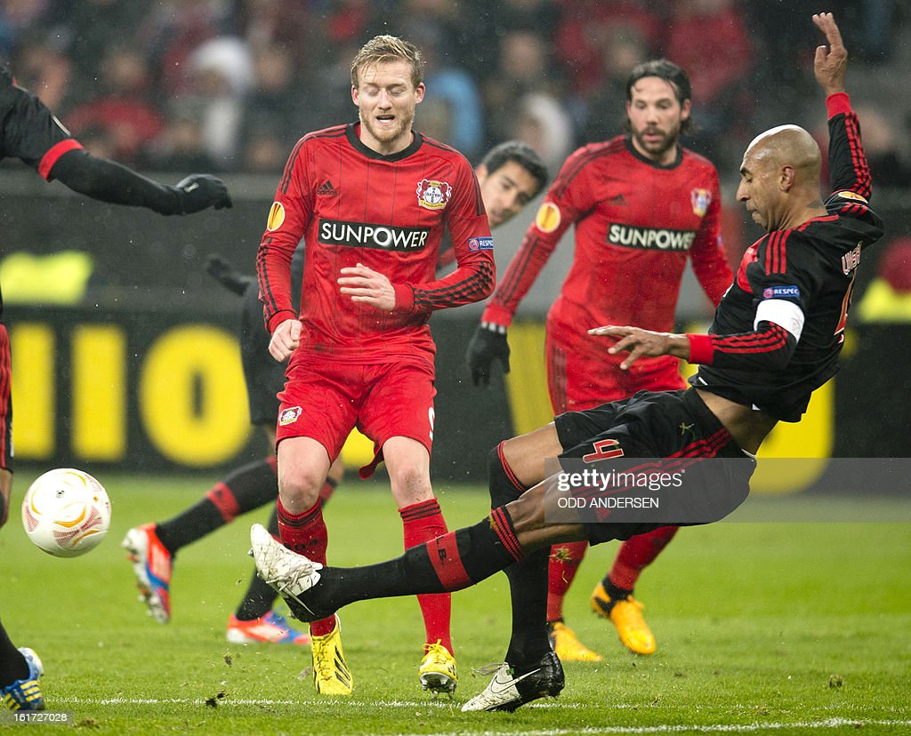 Benfica's Brazilian defender 'Luisao' Silva (R) and Leverkusen's striker Andre Schuerrle (L) vie during the UEFA Europa League football match Bayer 04 Leverkusen vs SL Benfica on February 14, 2013 in Leverkusen, western Germany.