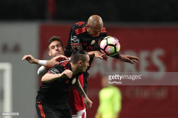 Benfica's Brazilian defender Luisao vies with Braga's Portuguese forward Pedro Santos and Benfica's Serbian midfielder Ljubomir Fejsa during the...