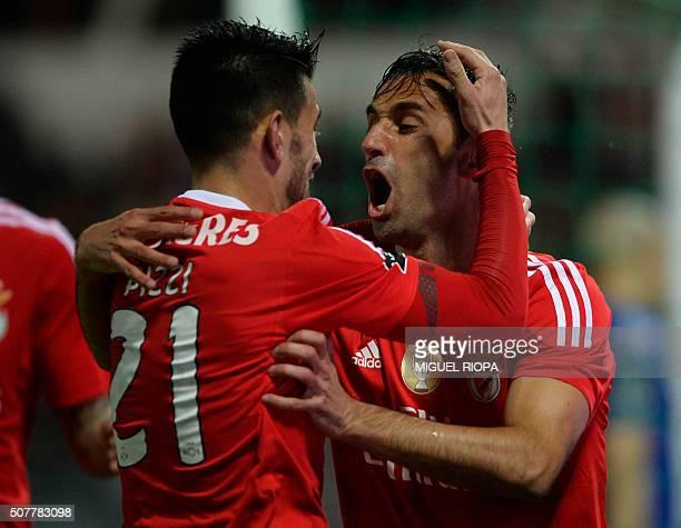 Benfica's Brazilian forward Jonas celebrates a goal with teammate Benfica's midfielder Pizzi during the Portuguese league football match Moreirense...
