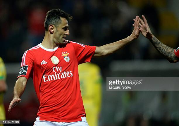 Benfica's Brazilian forward Jonas celebrates after scoring a goal during the Portuguese league football match FC Pacos de Ferreira vs SL Benfica at...