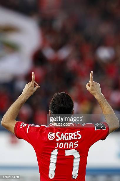 Benfica's Brazilian forward Jonas celebrates after scoring against Belenenses during the Portuguese league football match CF Os Belenenses v SL...