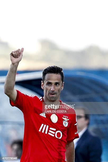 Benfica's Brazilian forward Jonas celebrates after scoring during the Portuguese league football match CF Os Belenenses v SL Benfica at the Restelo...