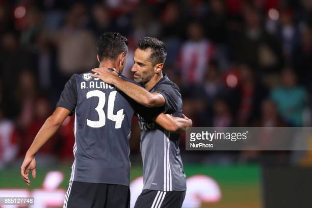 Benfica's Brazilian forward Jonas celebrates after scoring goal with teammate Benfica's Portuguese defender Andre Almeida during the Premier League...