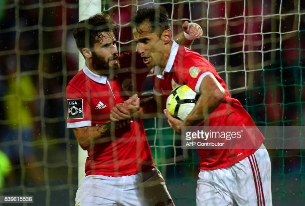Benfica's Brazilian forward Jonas celebrates with Benfica's forward Rafa Silva after scoring a penalty shot during the Portuguese league football...