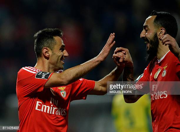 Benfica's Brazilian forward Jonas celebrates with teammate Greek forward Konstantinos Mitroglou after scoring a goal during the Portuguese league...