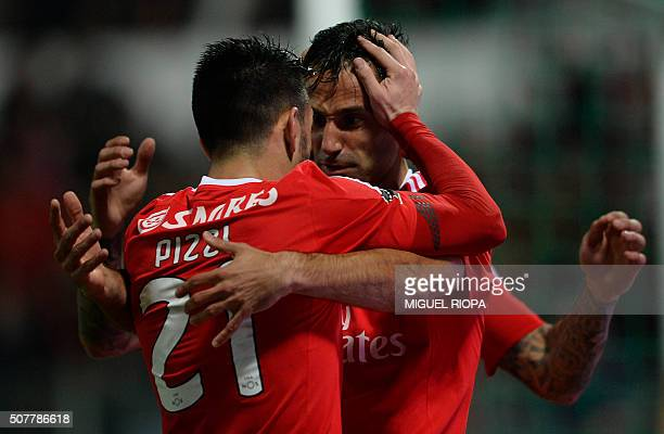 Benfica's Brazilian forward Jonas celebrates with teammate midfielder Pizzi after scoring the opening goal during the Portuguese league football...