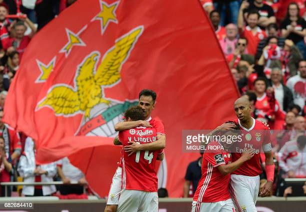 Benfica's Brazilian forward Jonas celebrates with teammates after scoring during the Portuguese league football match SL Benfica vs Vitoria Guimaraes...