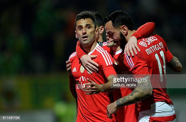 Benfica's Brazilian forward Jonas is congratulated by Benfica's Greek forward Konstantinos Mitroglou and other teammates after scoring a goal during...