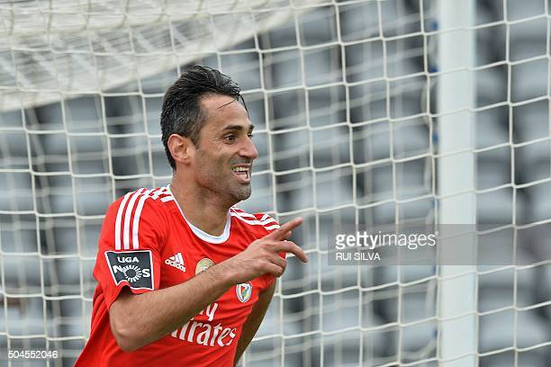 Benfica's Brazilian forward Jonas Oliveira celebrates after scoring during the Portuguese league football match CD Nacional vs SL Benfica at the Da...
