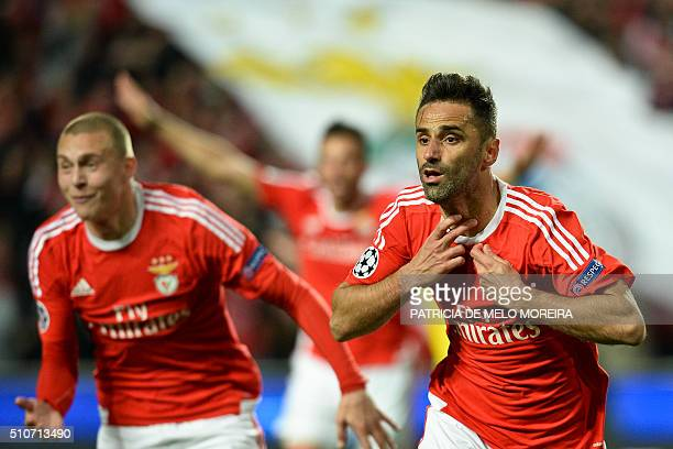 Benfica's Brazilian forward Jonas Oliveira celebrates after scoring during the UEFA Champions League round of 16 football match SL Benfica vs FC...