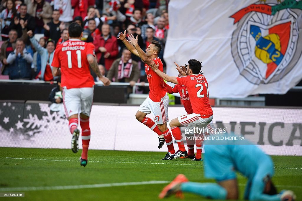 Benfica's Brazilian forward Jonas Oliveira (2ndL) celebrates with his teammates after scoring against Rio Ave during the Portuguese league football match Benfica vs Rio Ave at Luz stadium in Lisbon on December 20, 2016.