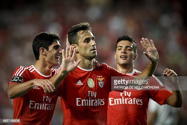 Benfica's Brazilian forward Jonas Oliveira celebrates with his teammates Benfica's forward Goncalo Guedes and Benfica's Mexican forward Raul...
