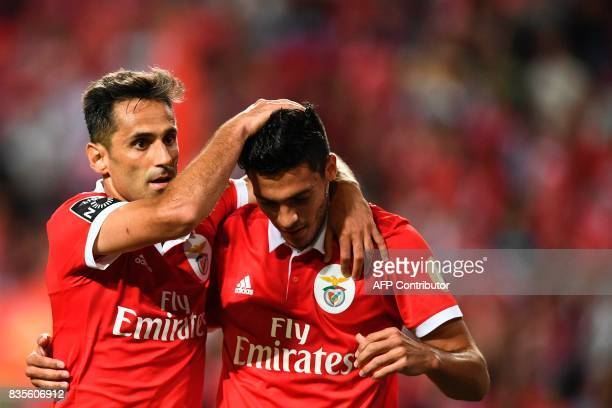 Benfica's Brazilian forward Jonas Oliveira celebrates with his teammate Benfica's Mexican forward Raul Jimenez after scoring during the Portuguese...