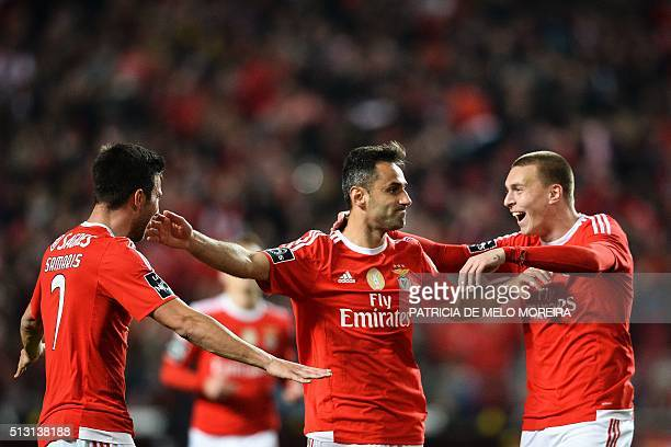 Benfica's Brazilian forward Jonas Oliveira celebrates with teammates after scoring during the Portuguese league football match SL Benfica vs Uniao...