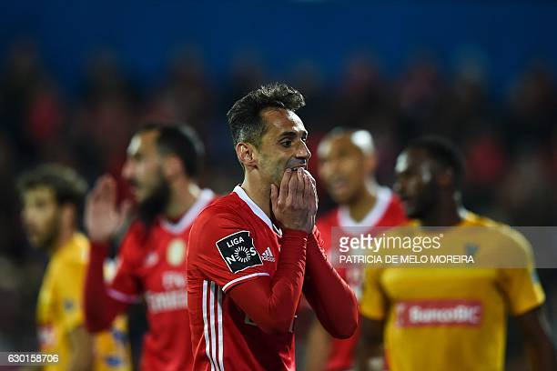 Benfica's Brazilian forward Jonas Oliveira gestures after missing a goal opportunity during the Portuguese league football match GD Estoril Praia vs...