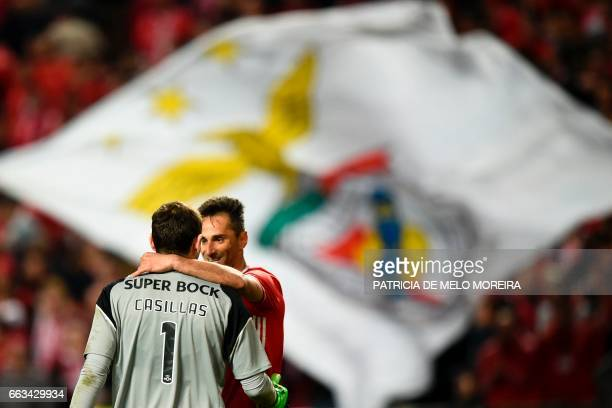 Benfica's Brazilian forward Jonas Oliveira greets Porto's Spanish goalkeeper Iker Casillas at the end of the Portuguese league football match SL...