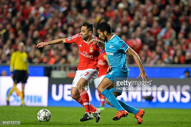 Benfica's Brazilian forward Jonas Oliveira vies with Zenit's Argentine defender Ezequiel Garay during the UEFA Champions League round of 16 football...