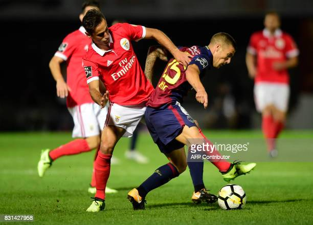 Benfica's Brazilian forward Jonas vies with Chaves' midfielder Pedro Tiba during the Portuguese league football match between GD Chaves and SL...