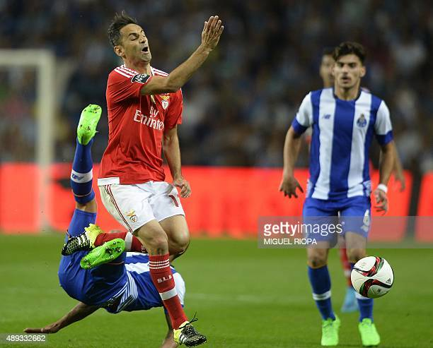 Benfica's Brazilian forward Jonas vies with Porto's Uruguayan defender Maxi Pereira during the Portuguese league football match FC Porto vs SL...