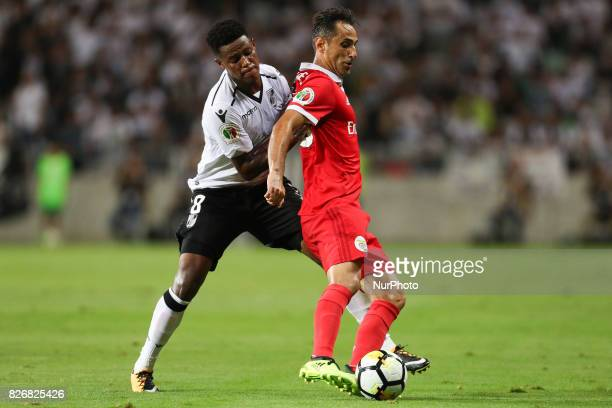 Benfica's Brazilian forward Jonas vies with Vitoria SC's South Africa midfielder Bongani Zungu during the Candido Oliveira Super Cup match between SL...